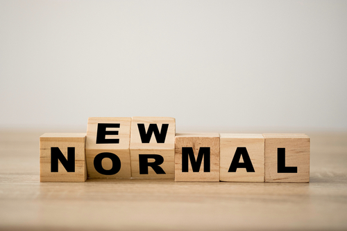 Wooden blocks spelling 'new normal'